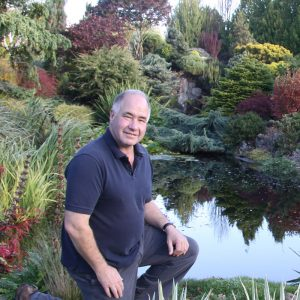 John in his garden, one of the finest private gardens in the UK